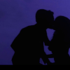 Still image from the short film, Shadowplay, showing the shadows of a couple kissing.