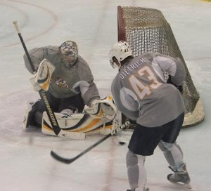 Pekka Rinne stops defenseman Robert Dietrich during goaltending practice.