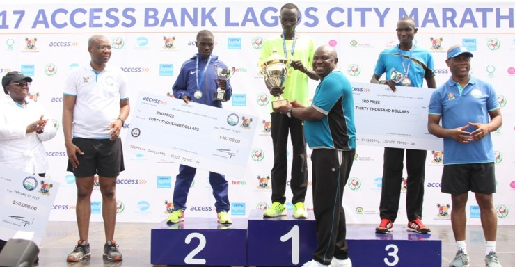 Lagos State Governor, Mr. Akinwunmi Ambode (3rd right), presenting the trophy to the Winner of the 2017 Lagos City Marathon, Abraham Kiptum from Kenya (middle) while 3rd Prize Winner, Kiprotich Kiroi from Kenya (2nd right); Group Managing Director, Access Bank, Mr. Herbert Wigwe (right); 2nd Prize Winner, Ronny Kipkoech Kiboss from kenya (3rd left); President, Nigeria Stock Exchange, Mr. Aigboje Aig-Imoukhuede (2nd left) and Deputy Governor, Dr. (Mrs) Oluranti Adebule (left) watch with admiration during the 2017 Lagos City Marathon at the Eko Atlantic City, on Saturday, February 11, 2017.