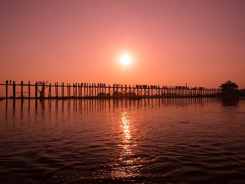 Myanmar sunset over U Bein Bridge