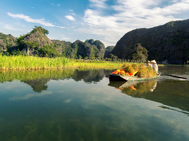 Row through Tam Coc, Vietnam