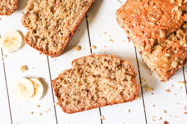 Slice of gluten free banana bread with sliced bananas and pecans
