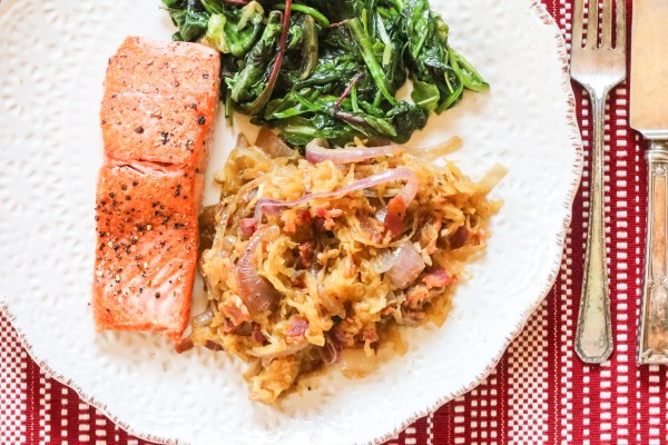 Plate with Roasted Spaghetti Squash with Bacon and Caramelized Onions and salmon with wilted greens