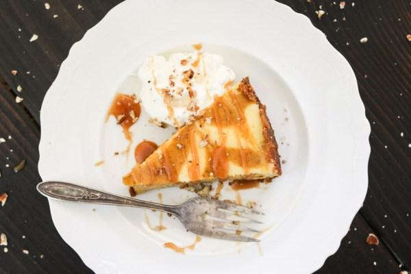 Gluten free Marbled Pumpkin Cheesecake with salted caramel drizzle and whipped cream on a plate