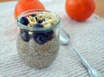 orange chia pudding with berries and almonds