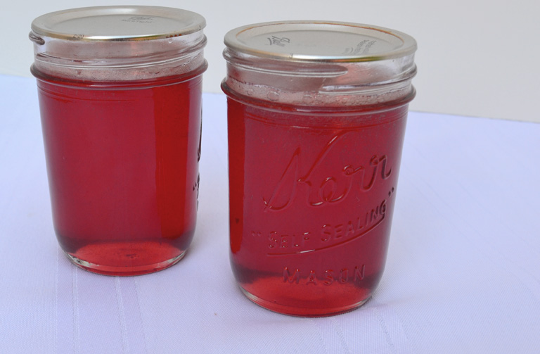 jars of homemade peach plum jelly