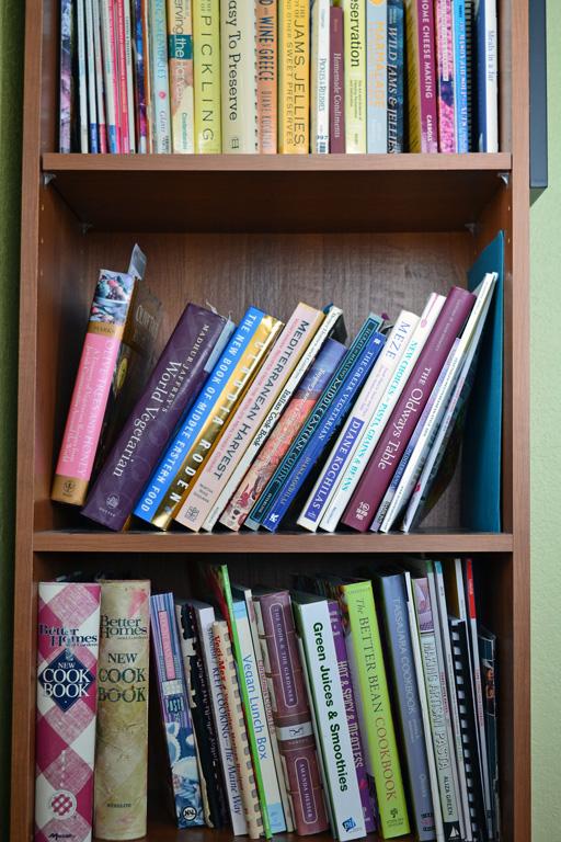 rows on cookbooks on shelf