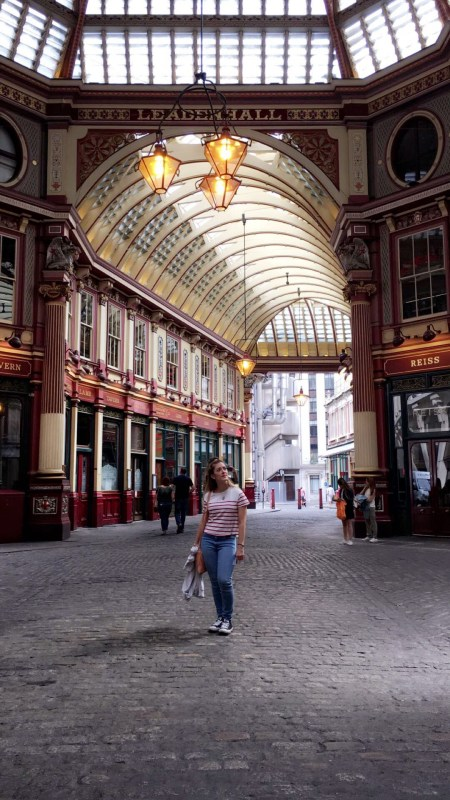Girl looking up at the ceiling in Leadenhall Market