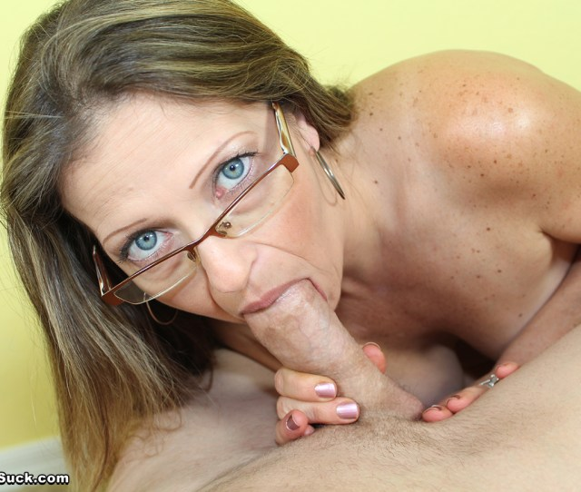 Brunette Milf Giving A Blowjob