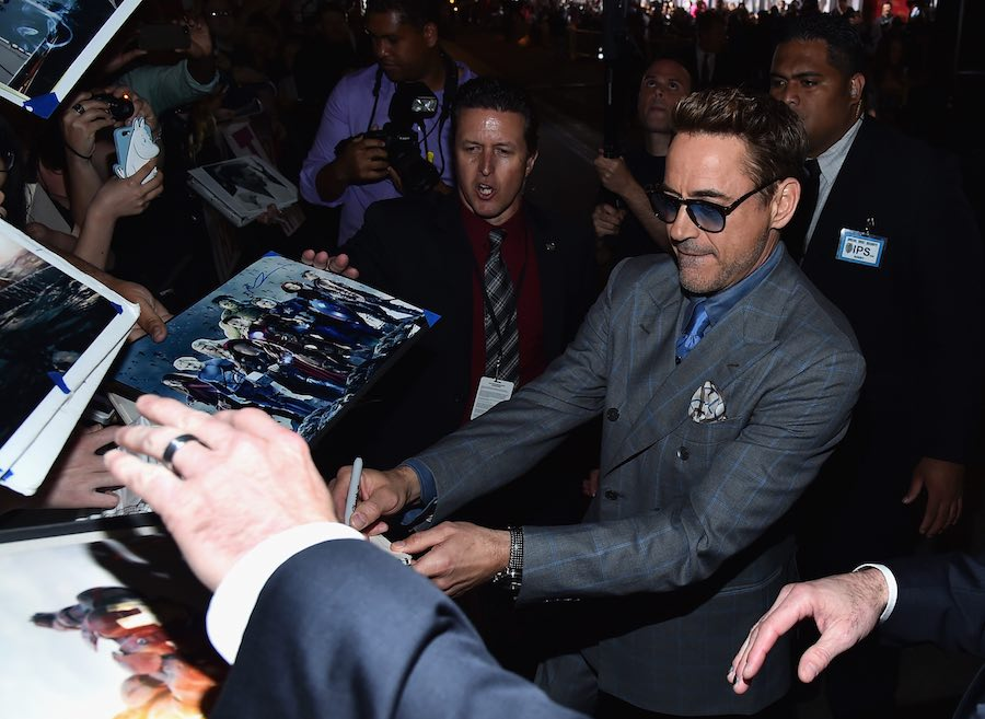 "Robert Downey Jr. signs autographs for fans at the world premiere of Marvel's ""Avengers: Age Of Ultron"" at the Dolby Theatre on April 13, 2015 in Hollywood, California. Photo by Alberto E. Rodriguez/Getty Images for Disney"
