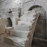 Crusader steps leading to grille offering a view into venerated cave (© Gregory Jenks)