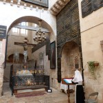 "Russian nun praying in front of ""Judgement Gate"" threshold (Seetheholyland.net)"