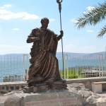 Statue of St Peter at Capernaum, with Sea of Galilee in background (Seetheholyland.net)