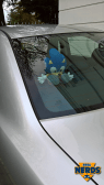 You know you're in the right location when a car features a Sonic plush toy