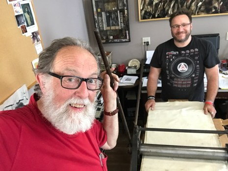 Michael Seiler and Lee Casey with newly delivered etching press at Seilers' Studio.