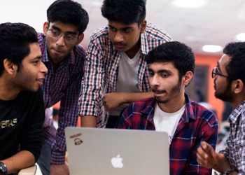 In this picture taken on October 27, 2018, Indian undergraduate students discuss their project as they take part in HackCBS, a 24 hour event of software development also called 'hackathon', at the Shaheed Sukhdev College of Business Studies (SSCBS) in New Delhi. - Students from all over India gathered in teams to take part in a challenge to develop their ideas in the fields of Internet of Things (IoT), Artificial Intelligence (AI), Blockchain, Mobility and Education and Financial technology. (Photo by XAVIER GALIANA / AFP)        (Photo credit should read XAVIER GALIANA/AFP via Getty Images)