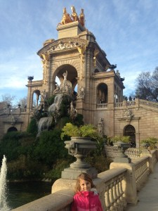 Quinn standing in front of fountain