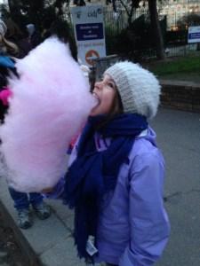 Mackenzie taking a bit of a huge cotton candy pop