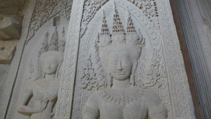 Apsara deities carved into the stone wall at Angkor Wat