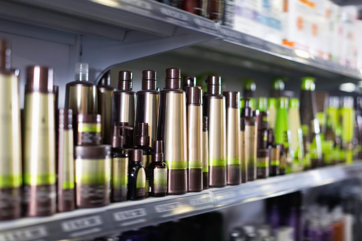 Shelves with hair care products in a cosmetics showroom indoor