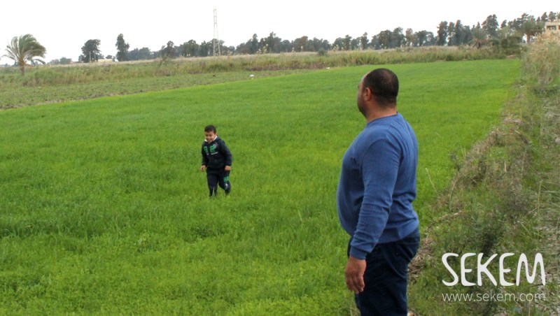 Ibrahim Al-Naggar with his son on his farm.
