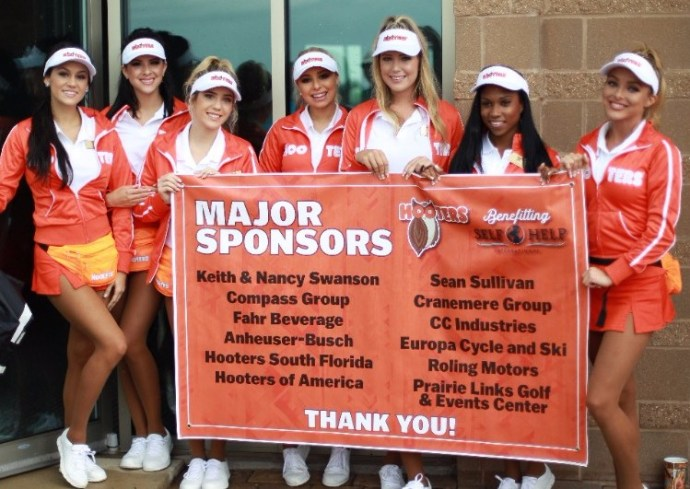 group of Hooters girls hold smile holding poster of major Self-Help sponsors