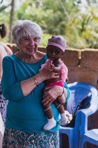 Mary Jane Oakland holds an infant in rural Ghana