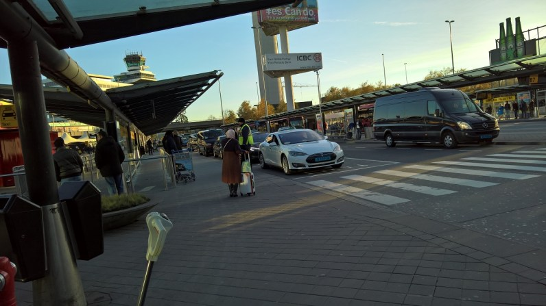 Tesla cars in fron of the airport