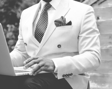 Man in Suit with Laptop