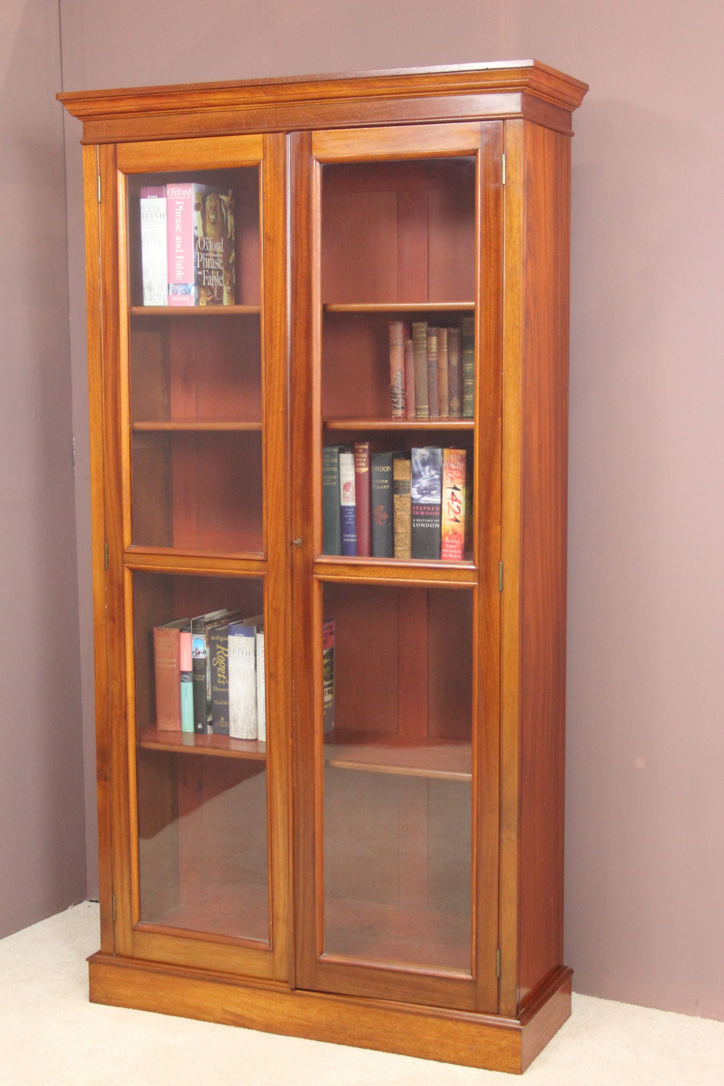 A Victorian Mahogany Bookcase With A Moulded Cornice