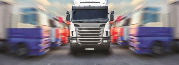 truck goes frontally along ranks of trucks