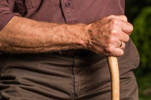 man holding a wooden stick