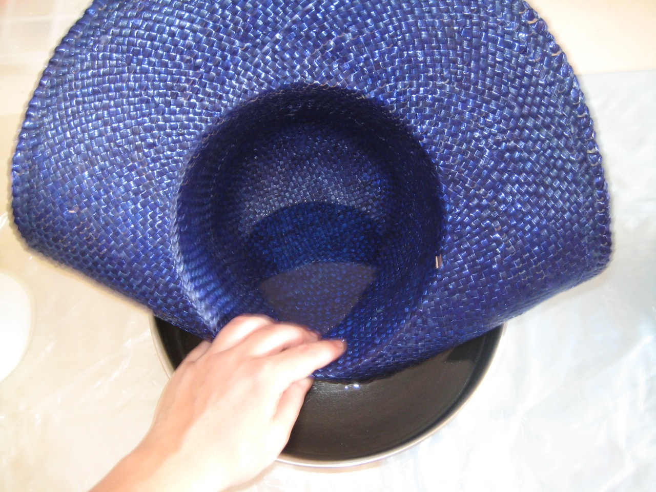13a908af7ec Gently introduce your hat to the bowl of warm water. The straw will become  more pliable as it becomes wet