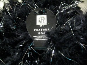If you've not got a huge budget for feathers, use something cheap and fluffy as filler.  I'm starting with a rather tasteless feather boa.