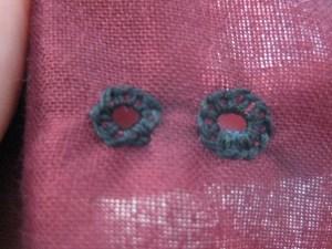Finished eyelets, front side shown.