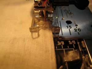 Sew, encasing the seam allowance as closely as possible without sewing into it.