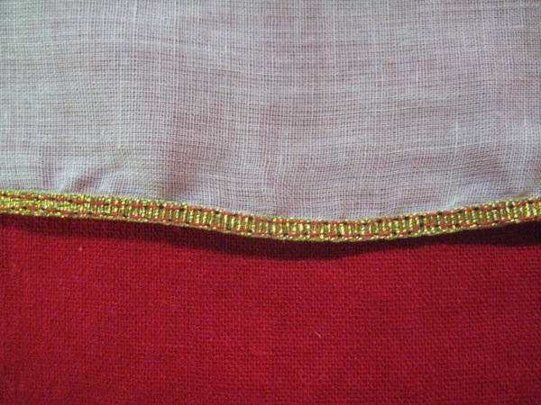 """A Ribbon Hem, front side, worked with 1/8"""" wide gold grosgrain."""