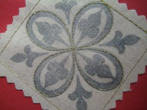 the curved edges of the stamped design have been traced in thread