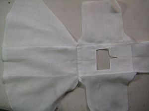 Sleeves sewn to chemise