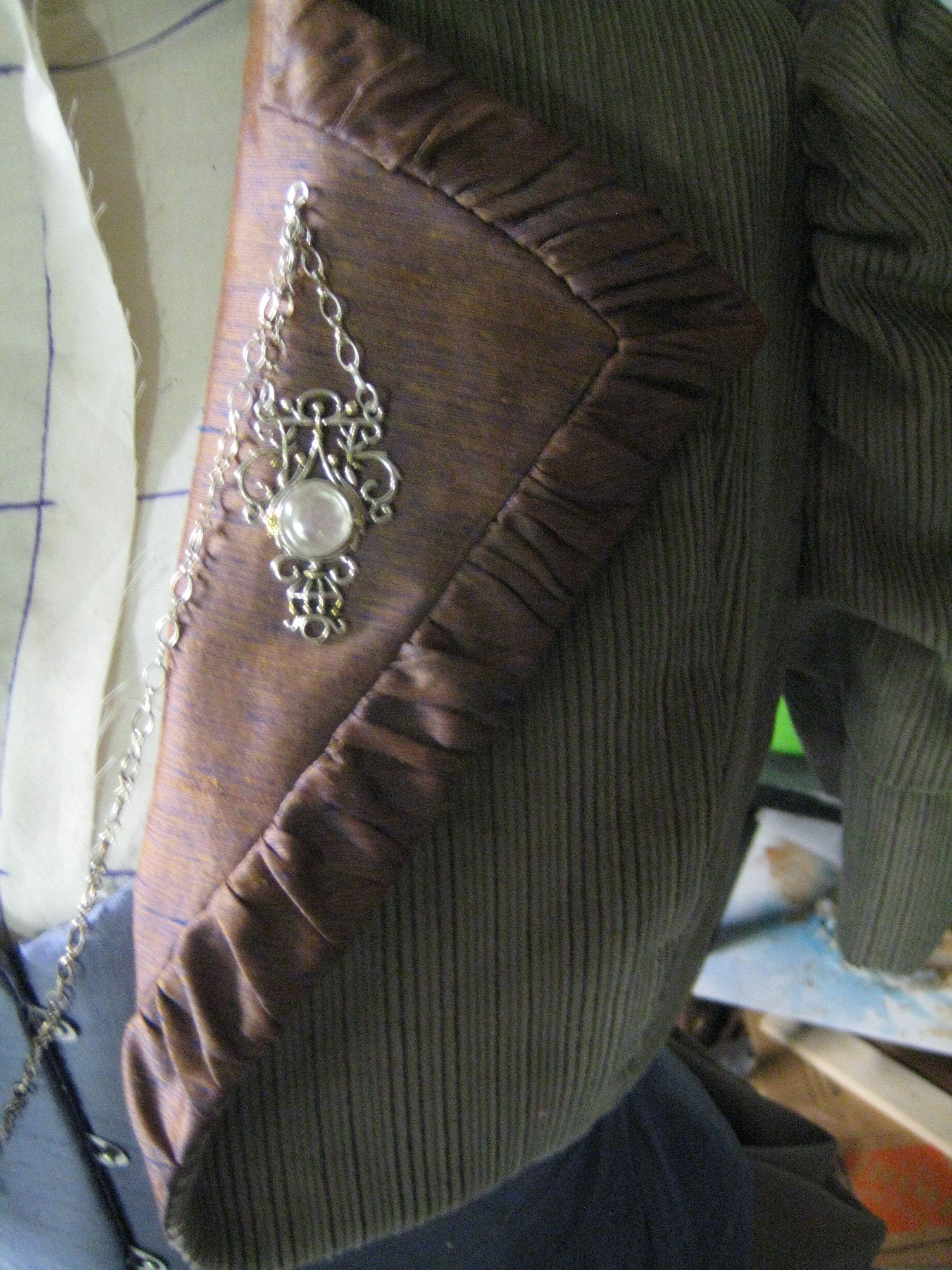 closeup of the collar and pin