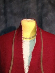 Collar - right pad stitched, left not.