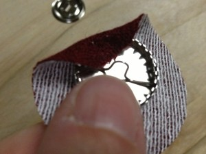 beginning to attach fabric to button