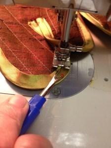 using seam ripper to control pucker