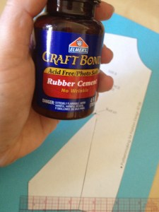 "I use Rubber Cement to attach the sloper to the colored paper.  The bottles are usually shaped about like this.  Find the cheapest one that says ""Rubber Cement"" on the bottle."