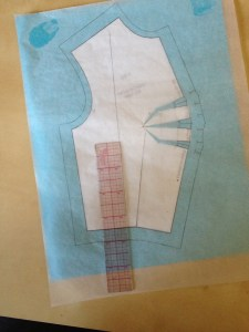 We want the grain to run relatively straight up and down the body.  (It's never completely up and down all around the torso, because the torso isn't flat.)  So we're going to place our grain line perpendicular to the bottom edge of the piece.  Remember that when the tucks are sewn, the bottom edge will appear straight on the body.