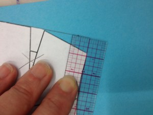 The new shoulder line should end square above the old shoulder point.  (I keep saying square.  It's important.  Make sure you're using the ruler as your guide!)