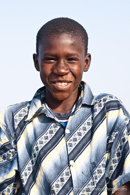 A happy kid posing on the shores of Senegal river in N'Dar Tout quarter of Saint-Louis, Senegal. Photo by Marko Preslenkov.