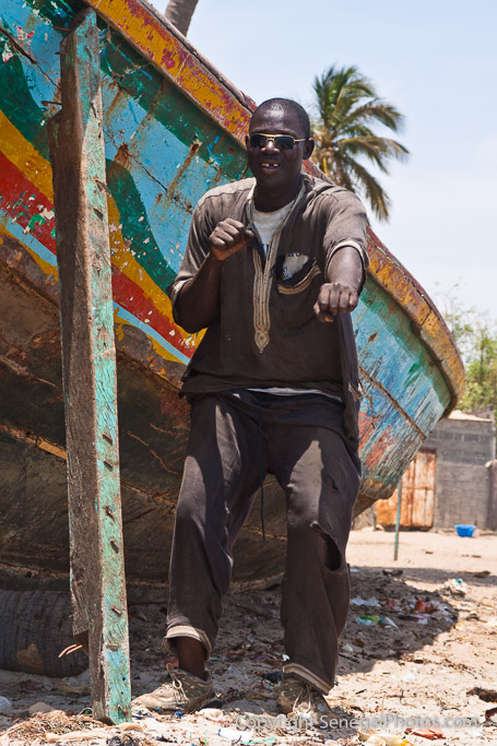 A man claiming to be marabou showing off his skills on the beach in Joal-Fadiout, Senegal. Photo by Marko Preslenkov.