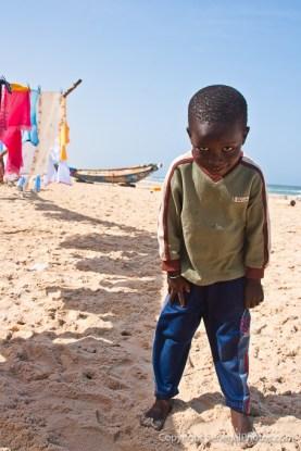 A little villain looking for a game partner on Atlantic ocean beach in N'Dar Tout quarter of Saint-Louis, Senegal. Photo by Marko Preslenkov.