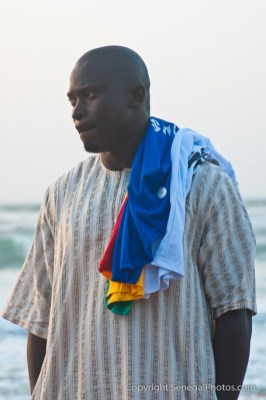 Man plying his trade selling t-shirts on the beach at Yoff virage, Dakar, Senegal. Photo by Marko Preslenkov.